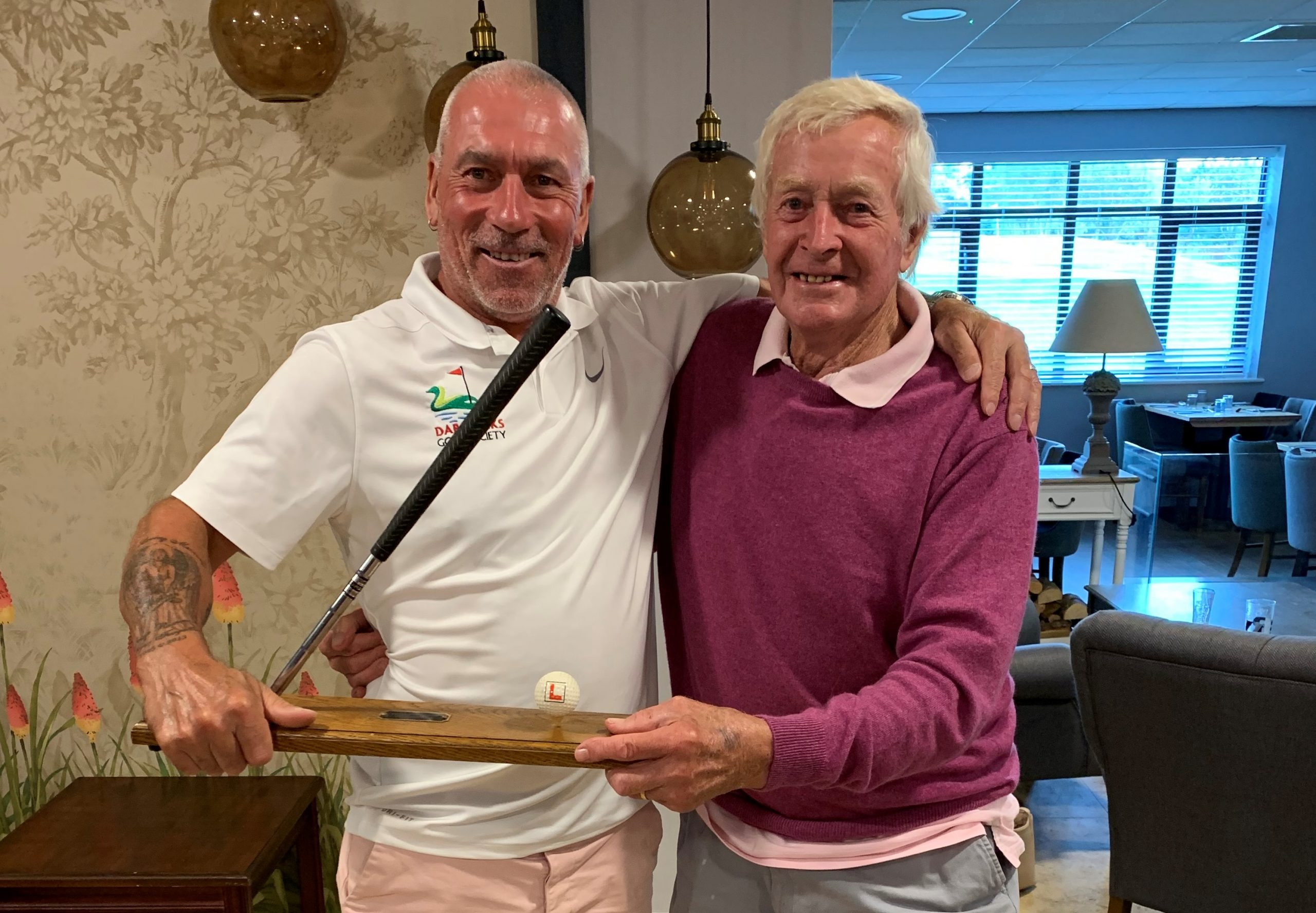 Pete Keen & Donald Barnes enjoy the wrestle for 'winning' the Buried Head Trophy!