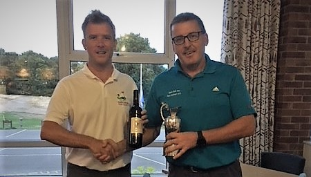 Chris Faulkner receiving the new silverware after winning the Autumn Masters with a superb 41 points.